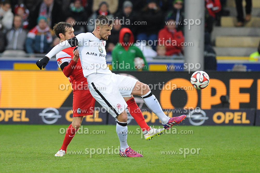 31.01.2015, Schwarzwald Stadion, Freiburg, GER, 1. FBL, SC Freiburg vs Eintracht Frankfurt, 18. Runde, im Bild (l.) Julian Schuster (SC Freiburg) im Zweikampf, Aktion, mit (r.) Haris Seferovic (Eintracht Frankfurt) // during the German Bundesliga 18th round match between SC Freiburg and Eintracht Frankfurt at the Schwarzwald Stadion in Freiburg, Germany on 2015/01/31. EXPA Pictures &copy; 2015, PhotoCredit: EXPA/ Eibner-Pressefoto/ Laegler<br /> <br /> *****ATTENTION - OUT of GER*****