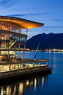 The Vancouver Convention Center in the early evening. Photographed between the Vancouver Convention Center and Canada Place in Vancouver, British Columbia, Canada.  The North Shore Mountains (and North Vancouver) are in the background across Burrard Inlet.