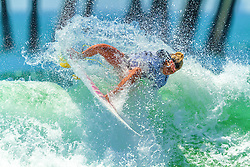 HUNTINGTON BEACH, CA/USA (Thurs, June 25) – Surfer Coco Ho of Hawaii surfs during during round 3 heat 3 at the 2013 Vans U.S. Open of Surfing. Coco won first place with a score of 15.67 points. She now moves on to quarter finals. PHOTO © Eduardo E. Silva/SILVEXPHOTO.COM.