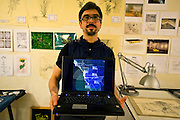Tijuana Mexico ..Raul Cardenas, conceptional artist and founder of Torrolab, at his studio..While working on this long term project 'La Frontera' I want to examine the cultural and humanitarian activities on both sides of a border that keeps the United States and Mexico apart with a wall of steel already 600 miles long. The turf wars of drug cartels, arms trafficking and rampant kidnappings turned cities like Tijuana into some of the most dangerous places on earth. Despite the violence many brave artists, photographers, architects, poets, humanitarians, teachers etc live and work in the shadow of the wall on both sides and have a positive influence on this region; they are the focus of my long term project along the border. (Over time I plan to cover the entire length from the Atlantic to the Pacific, these images were taken in and around Tijuana).© Stefan Falke