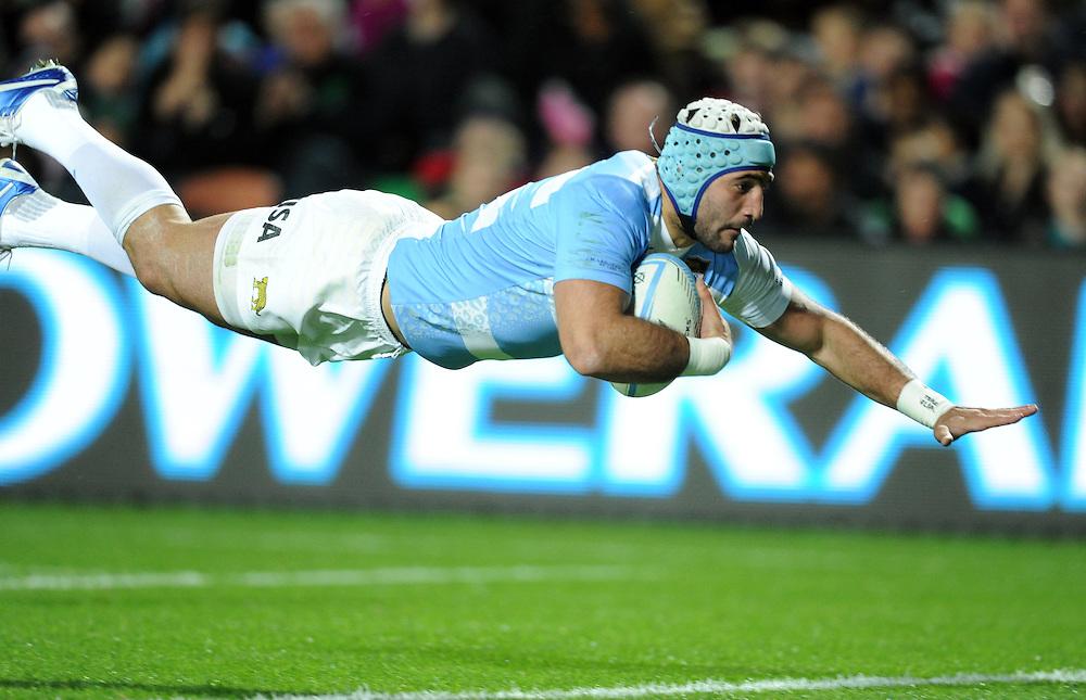 Argentinas' Juan Manuel Leguizamon dives into score against  New Zealand in the 2013 Rugby Championship match at Waikato Stadium, Hamilton, New Zealand, Saturday, September 07, 2013. Credit:SNPA / Ross Setford