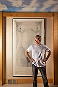 Andreas Bechtler, Art Collector.  Founder of the Bechtler Museum of Modern Art in Charlotte, NC.  Photographed in 2008 in his home in Charlotte, NC for Apollo Magazine. Seen here with Markus Raetz's 'Ark (Nude)', 1977 - in ink on damask tablecloth.