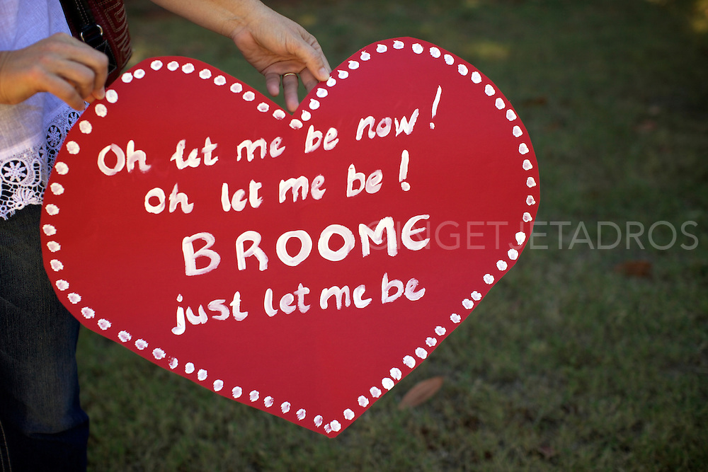 """A lady holds a placard stating """"Oh let me be now! Oh let me be! Broome let me be."""" During a Broome family gathering in Broome's town centre. The message of the Broome families is """"Broome does not want a gas hub on its doorstep.""""."""