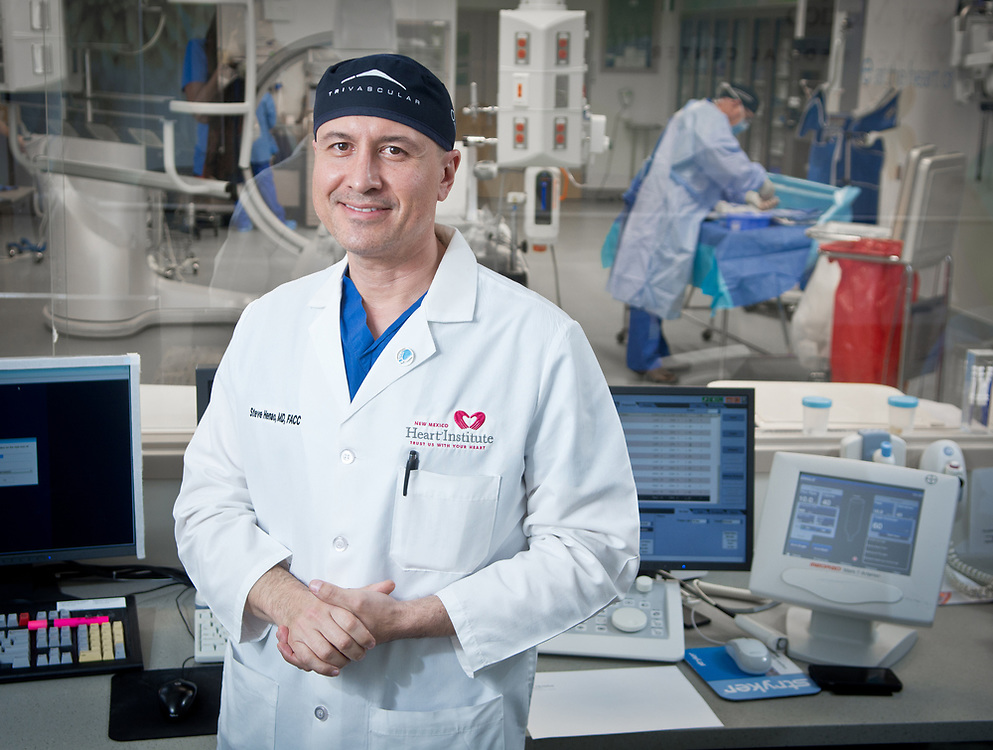 mkb032217/metro/Marla Brose --  New Mexico Heart Institute physician Steve Henao, a vascular surgeon, performs a new procedure called Transcarotid Artery Revascularization to prevent strokes. (Marla Brose/Albuquerque Journal)
