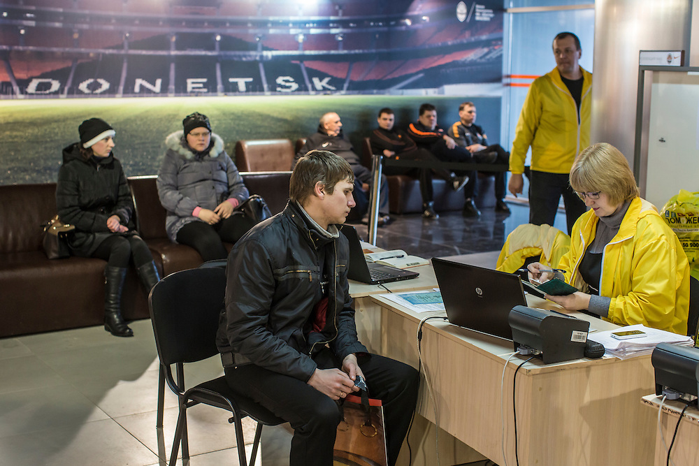 DONETSK, UKRAINE - JANUARY 26, 2015: A man signs up to receive humanitarian assistance at the Donbass Arena soccer stadium in Donetsk, Ukraine. With many residents finding it difficult to access bank accounts or find work, humanitarian needs are rising. CREDIT: Brendan Hoffman for The New York Times