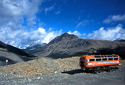 Old bus left on Columbia Icefields in Jasper National Park, Alberta, Canada. This kind of bus was used for taking tourist to the glacial on Columbia Icefield. Now more modern and much bigger busses are used.<br />
