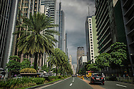 Ayala Avenue in Makati financial district, seat of the Filipino wealth.  The Atlantic Magazine wrote, &quot;huge sectors of Filipino industry (such as banking, telecommunications, and property development) are almost entirely monopolized by a few elite political families, most of whom have been in power since the Spanish colonial era.  The Spanish favored a small group of families to more easily control the local populace and then the Americans found it expedient to perpetuated that system.  Now, long after their colonial masters have left, those same families run the country, and control its economy, as if it were their own personal colony.  <br /> <br /> Don Jose Bonifacio Roxas, an ancestor of the Zobel de Ayala family bought the Jesuit, Hacienda de San Pedro de Macati in 1851.  Since that time, the Zobel de Ayala family, and their Ayala  Corporation, has been instrumental in the development of Makati, the new financial insta-city of Bonafacio Global City, and the Beverly Hills of Manila, Forbes Park.  The Ayala family remain one of the richest families in the Philippines.  Manila, Philippines.<br /> <br /> According to Forbes Magazine, Jaime Zobel de Ayala is the 8th richest man in the Philippines in 2015, worth an estimated US$ 3.5 billion.