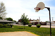On a hot summer afternoon, the local park in downtown Sheldon, IL is quiet, it's basketball courts empty.
