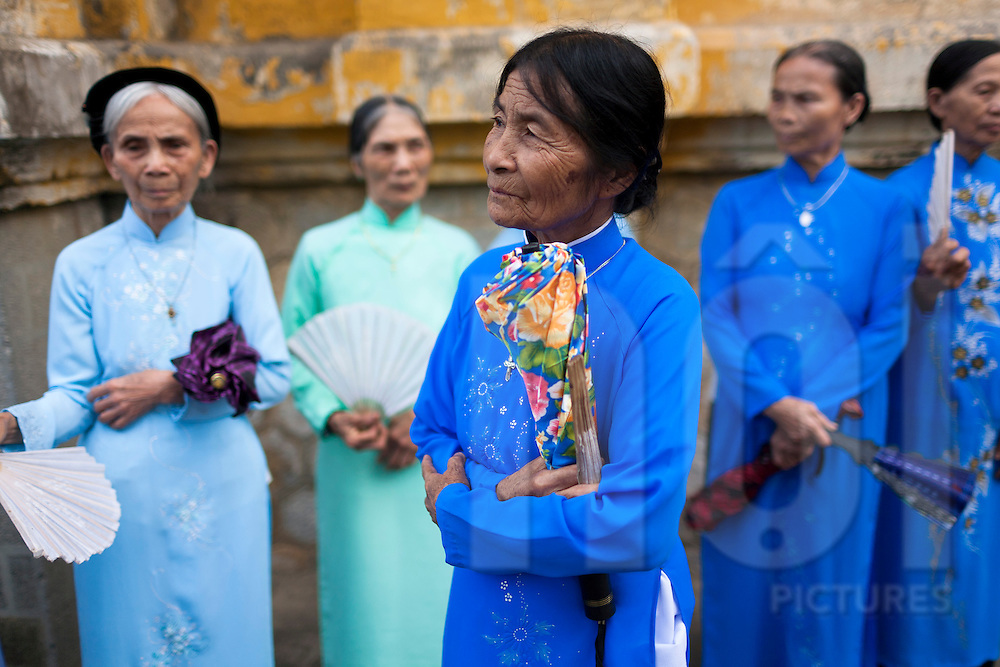 Elderly vietnamese women wears traditional dress Ao Dai. Vietnam, Asia