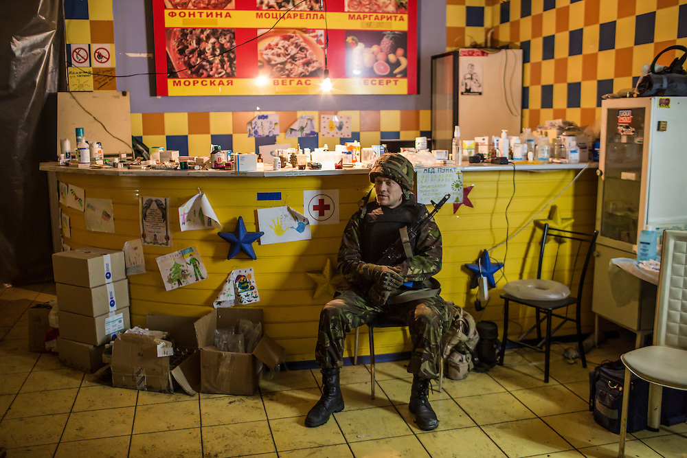 A Ukrainian soldier sits inside a medical treatment point for Ukrainian fighters on February 8, 2015 in Debaltseve, Ukraine. Fighting between pro-Russia rebels and Ukrainian forces there over the past two weeks has dealt steady casualties to Ukrainian fighters and civilians.