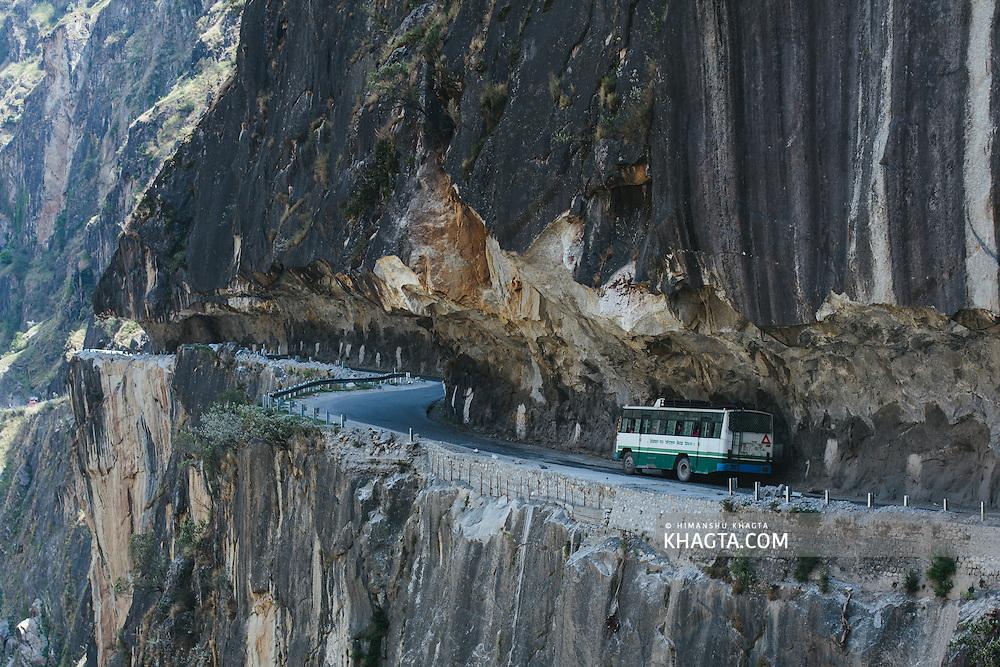 An HRTC Bus travelling across  Tranda Dhank, one of world's most dangerous roads.