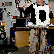 """Isaac Witkin working on plaster model of """"Aleph"""" sculpture. Published in catalog of his exhibition at Rider Univeristy, 2007.  Photo taken in 2006 with a Nikon D80 DSLR."""