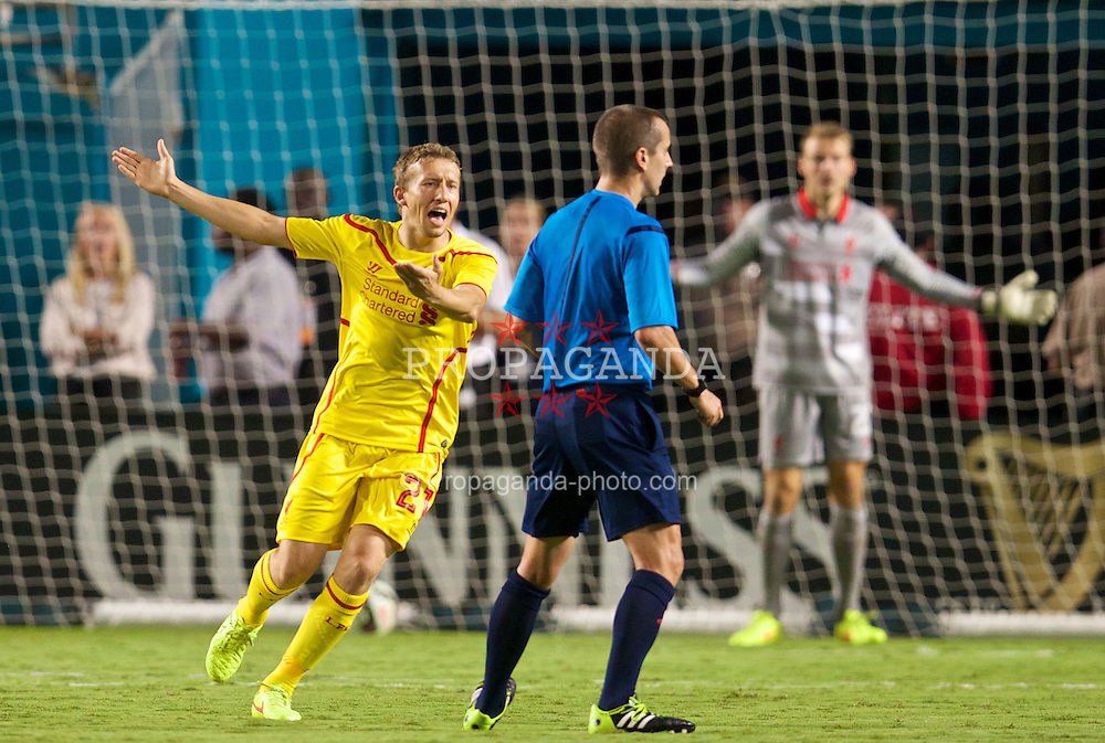 MIAMI, USA - Monday, August 4, 2014: Liverpool's Lucas Leiva complains to the referee after he awarded Manchester United a goal after the ball went out of play during the International Champions Cup Final match at the SunLife Stadium on day fifteen of the club's USA Tour. (Pic by David Rawcliffe/Propaganda)