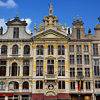 Guildhalls on Northeast of Grand Place in Brussels, Belgium <br /> The square called Grand Place became the hub for Brussels&rsquo; merchants about ten centuries ago but was completely destroyed by the French in 1695.  From the ashes, the local merchants (called guilds) each designed their adjoining buildings.  In this photo (left to right), they are the King&rsquo;s House annex (Chambrette de l&rsquo;Amman), the Pigeon (painters), Golden Galleon or Sloop (tailors), and the Angel (Abby of Forest). On top in the middle is a statue of Bishop St. Boniface.