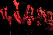 Fans of Slayer cheer as the band performs at the Roseland Ballroom November 11, 2004 in New York City. .Photo by Keith Bedford