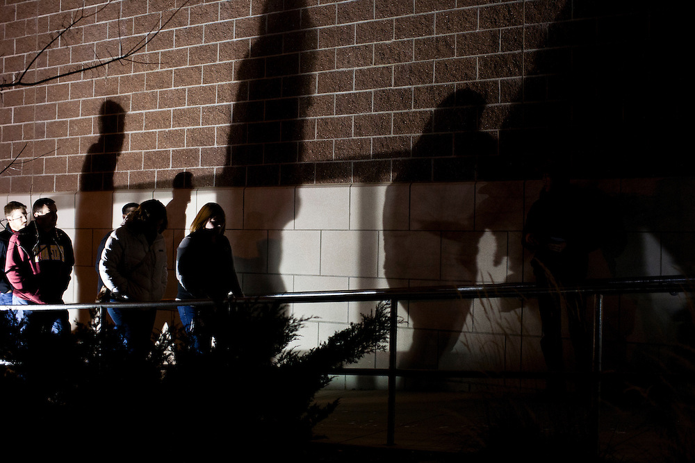 People arrive to hear Republican presidential candidate Ron Paul speak at a Salute to Veterans Rally on Wednesday, December 28, 2011 in Des Moines, IA.
