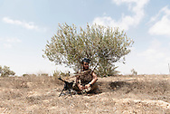 Libya: A fighter sympathising with Libya's Government of National Accord's (GNA) get some rest under a shade during an attack on the frontline with ISIS in Sirte. Alessio Romenzi