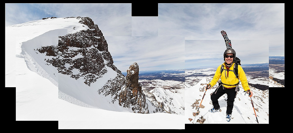 Backcountry skier Judd MacRae stands smiling just below the summit block of Hayden Peak, San Juan Mountains, Colorado.