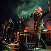 """COLUMBIA, MD - July 17th, 2014 - Troy Van Leeuwen, Dean Fertita and Josh Homme of Queens of the Stone Age perform at Merriweather Post Pavilion. The band's 2013 album, """"…Like Clockwork,"""" was the group's first album to top the US Billboard 200 album charts. (Photo by Kyle Gustafson / For The Washington Post)"""