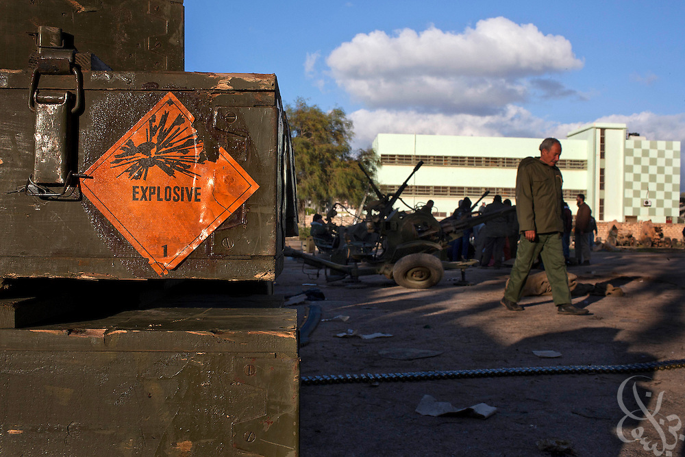 Boxes of ammunition are seen stacked near refurbished anti-aircraft weapons February 28, 2011 at a volunteer military camp in the eastern Libyan city of Benghazi. Opposition forces are on guard for airstrikes by forces of Libyan leader Col Muammar el-Qaddafi across eastern Libya after a reported airstrike on an opposition weapons deport near the city of Ajdabia. .Slug: Libya.Credit: Scott Nelson for the New York Times