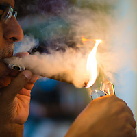TAMPA, FL -- July 2012 -- Dhaval Shukla of Kentucky lights up a cigar at the Tampa Sweetheart Cigar Company in Ybor City. (PHOTO /CHIP LITHERLAND)