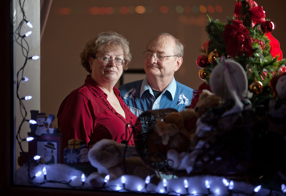 Jim and Linda Finkbeiner pose for a photograph in their Exeter, Ontario home, Tuesday, December 13, 2011. Jim suffers from early-stage Alzheimer's and he and Linda, his primary caregiver, do what they can to minimize the additional stresses on Jim's condition that the holiday season can create. THE CANADIAN PRESS/ Geoff Robins