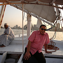 Ala'a Al-Aswany, a prominent Egyptian writer and founding member of the political movement Kefaya, relaxes on the Nile River in Cairo, Egypt on April 4, 2008. Trained as a dentist in Cairo and Chicago, Al-Aswany has contributed numerous articles to Egyptian newspapers on literature, politics, and social issues. His second novel, The Yacoubian Building, an ironic depiction of modern Egyptian society, has been widely read in Egypt and throughout the Middle East. It was translated into English and was adapted into a film (2006) and a television series (2007) of the same name. Chicago, Al-Aswany's latest novel, is set in the American city where he had attended college.
