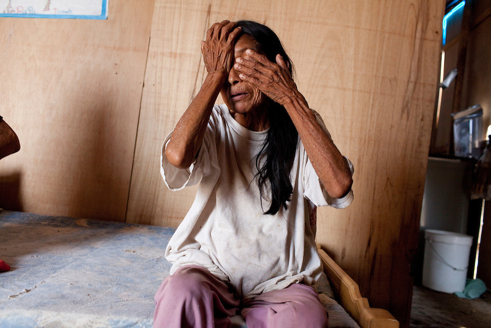 A woman with tuberculosis talks in her home on Monday, Apr. 13, 2009 in Ventanilla, Peru.