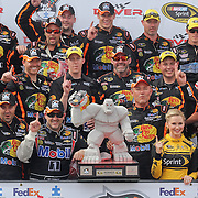 Tony Stewart of Stewart-Haas Racing celebrate with his team in victory lane after winning the NASCAR SPRINT CUP SERIES FEDEX 400 BENEFITING AUTISM SPEAKS  at Dover International Speedway in Dover, DE., Sunday,  June 02, 2013.1