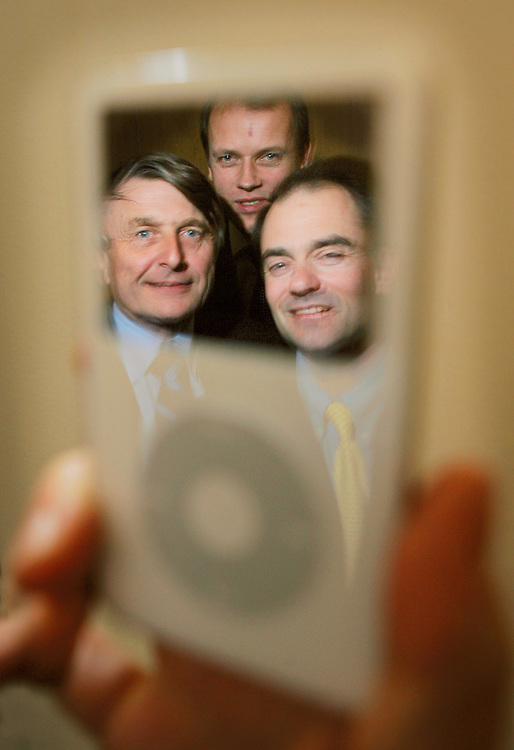 Sir Robin Saxby (left) Bill Parsons (rear) and Tim Score (right) from the digital tech company Arm Holdings PLC. They put the processors in Ipods.