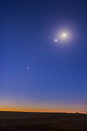 A gathering of planets in the dawn sky on October 8, 2015, with - from bottom to top: Jupiter, Mars, Venus and the Moon, with the star Regulus in Leo left of Venus. <br /> <br /> This is a 15-second exposure with shorter exposure blended in for the area around Venus and the Moon to avoid them overexposing too much. So not a true HDR, but using masking to blend the short exposure elements.