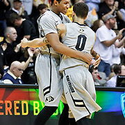 SHOT 2/14/13 9:28:54 PM - Colorado's Xavier Johnson #2 celebrates with teammate Askia Booker #0 in the closing moments of a win over Arizona during their regular season Pac-12 basketball game at the Coors Event Center on the Colorado campus in Boulder, Co. Colorado won the game 71-58. (Photo by Marc Piscotty / © 2013)