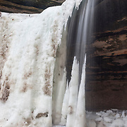 LaSalle Canyon Falls begins to thaw in late winter in Starved Rock State Park near LaSalle, Illinois. The 20-foot (6-meter) waterfall can completely freeze in winter. Here, part of the icefall has melted as is once again flowing as a waterfall.