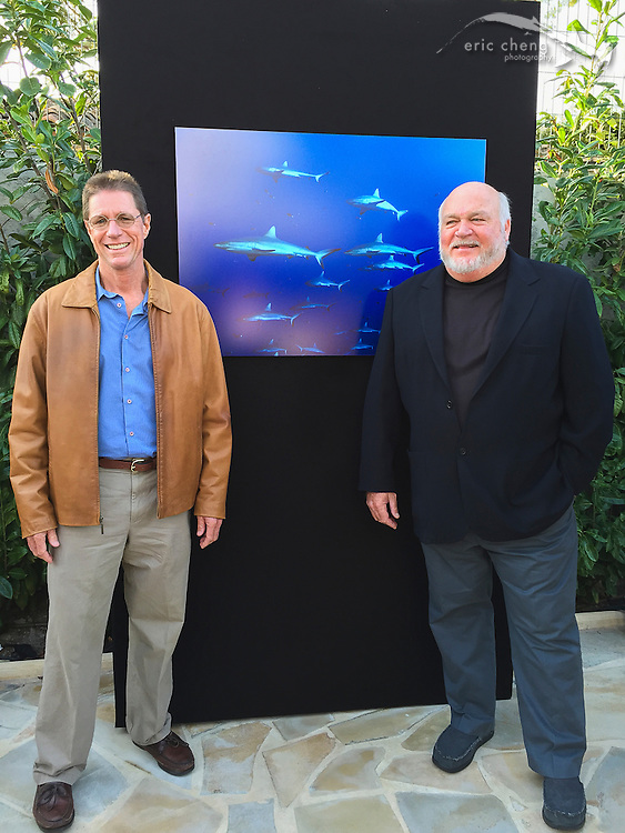 Mark Strickland and Bret Gilliam in front of Mark's shark photo.