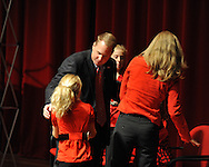 New Ole Miss head football coach Hugh Freeze and his family, wife Jill, and daughters Ragan, Jordan, and Madison, attend a press conference at the Ford Center on campus in Oxford, Miss. on Monday, December 5, 2011.