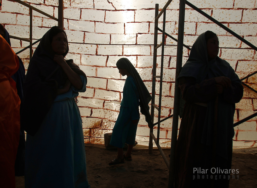 Actors wait to participate in an re-enactment of the crucifixion of Jesus Christ on Good Friday during Holy Week on the outskirts of Lima April 2, 2010.