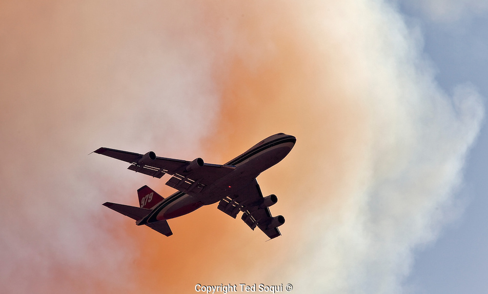 An Evergreen 747 jumbo jet does it inaugural live fire phoscheck drop  on the Station fire near the city of Acton, CA..Station fire near Acton, CA. .