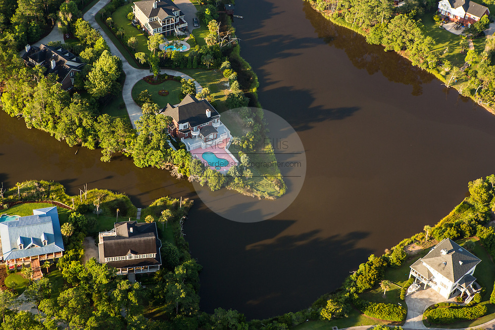 Aerial view of estate homes along the marsh in Mt Pleasant, SC