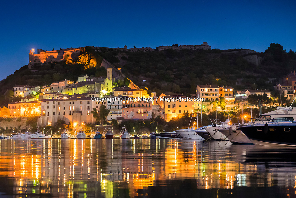Porto Ercole, Maremma, Tuscany, Italy, July 2016.  Porto Ercole may be smaller than Porto Santo Stefano,  but it's far more vibrant, shunning the relaxed, homely atmosphere of its neighbouring port for high class restaurants and expensive boutiques. The shoreline of Tuscany is at its best in the Maremma region; the name derives from Marittima, referring to the rugged coastal strip and inland hills of the Grosseto, Tuscany's southernmost province.  Photo by Frits Meyst / MeystPhoto.com