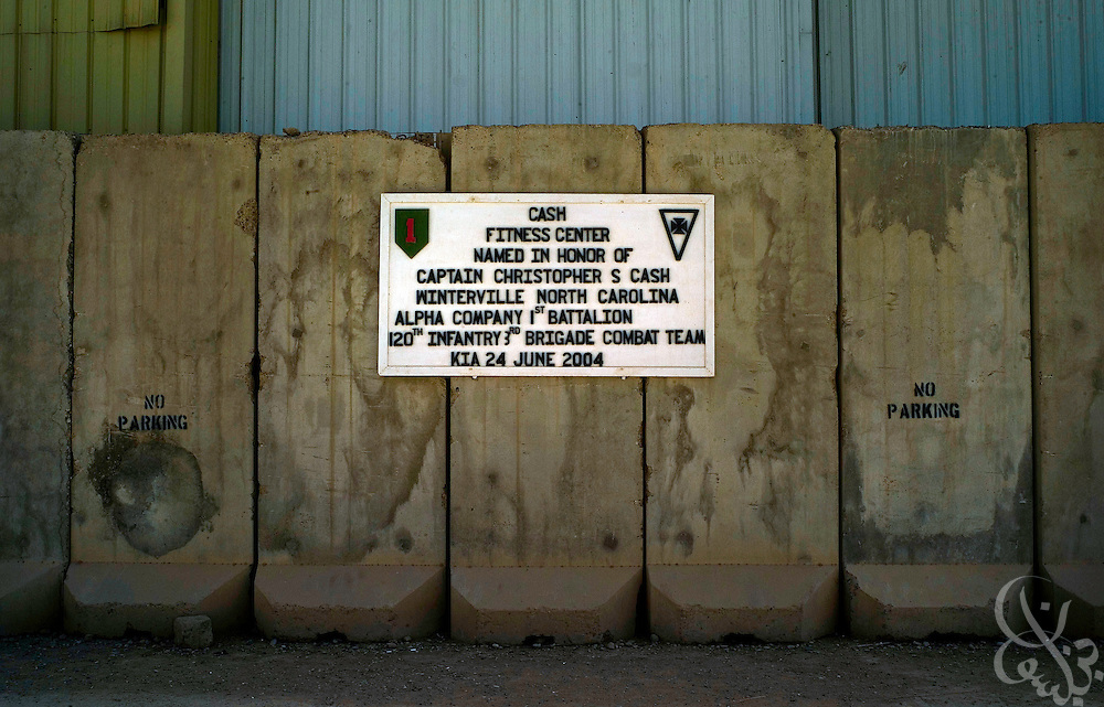 An sign outside the Cash Fitness center, American army gymnasium at Camp Warhorse in Bacouba, Iraq explains the origins of its' name June 27, 2007. Buildings on American bases like dining halls, libraries and fitness centers are often named for soldiers who have been killed.