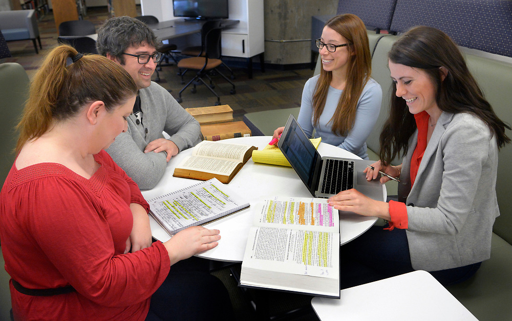 gbs030817e/LIVING -- Members of The New Mexico Innocence and Justice Project gathered in the Law School Libray are paralegal Sara Escobedor, law students Sean Dolan, Skylar Hendi-Hubbard and Margaret Kennedy, from left. Greg Sorber/Albuquerque Journal)