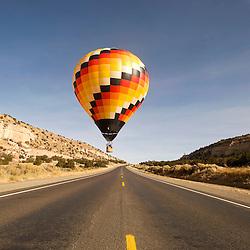 113012       Brian Leddy.A balloon flies over Highway 566 near Churchrock Friday morning during the Red Rock Balloon Rally.