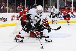 Dec 10, 2008; Newark, NJ, USA; Pittsburgh Penguins center Sidney Crosby (87) skates by New Jersey Devils defenseman Paul Martin (7) during the first period at the Prudential Center.