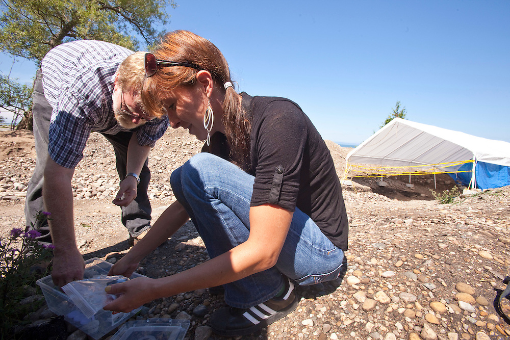 London, Ontario ---10-07-20--- Archeologists Bill Fitzgerald and Angela Gunn who represent the Saugeen first nation, organize some of the artifacts unearthed at the site of an archeological dig at the mouth of the Saugeen River in Southampton, Ontario, July 20, 2010.<br /> GEOFF ROBINS The Globe and Mail