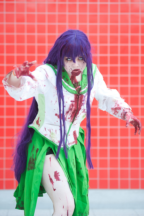 London, UK - 26 May 2013: Alex Whittle dressed as Saeko Busujima from Highschool of the Dead poses for a picture during the London Comic Con 2013 at Excel London. London Comic Con is the UK's largest event dedicated to pop culture attracting thousands of artists, celebrities and fans of comic books, animes and movie memorabilia.