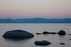 """Sunrise at Lake Tahoe 1"" - These  silhouetted rocks were photographed at sunrise near Sand Harbor, Lake Tahoe."