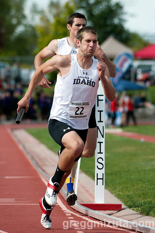 College of Idaho's Joseph Bolin receives the baton from Austin Basterrechea to start the third leg of the 4x400 at the Cascade Conference Championships on May 10, 2014 at Northwest Nazarene University, Nampa, Idaho. COI finished fourth with a time of 3:20.76.