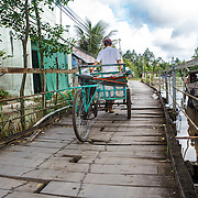 CAPTION: In 2006, a particularly bad flood destroyed a whole section of this road. LOCATION: An Binh Ward, Can Tho, Vietnam. INDIVIDUAL(S) PHOTOGRAPHED: N/A.
