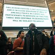 Danny Givens Jr. of Above Every Name Ministries in St. Paul, center, joins other clergy &amp; protestors associated with the Black Lives Matter movement as they stage a protest at the rotunda at the Mall of America in Bloomington, Minneapolis on December 20, 2014. <br /> <br /> Photo by Angela Jimenez <br /> www.angelajimenezphotography.com