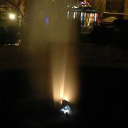 Water fountain glows in the dark next to the London Bridge in Lake Havaus City, Arizona.